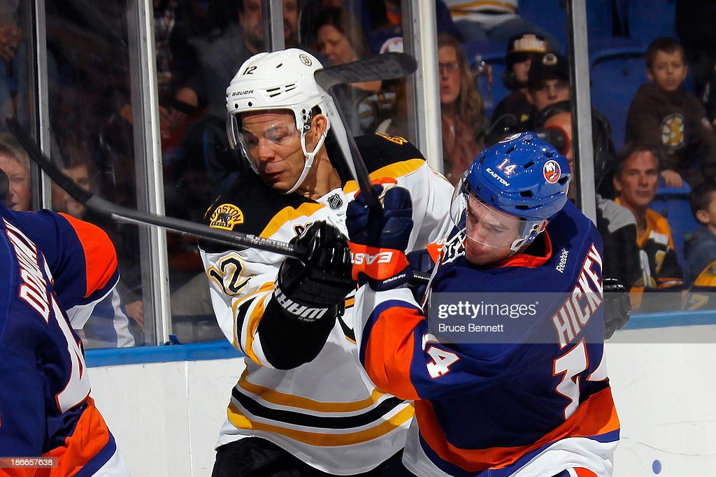 <a gi-track='captionPersonalityLinkClicked' href=/galleries/search?phrase=Jarome+Iginla&family=editorial&specificpeople=201792 ng-click='$event.stopPropagation()'>Jarome Iginla</a> #12 of the Boston Bruins collides with Thomas Hickey #14 of the New York Islanders during the third period at the Nassau Veterans Memorial Coliseum on November 2, 2013 in Uniondale, New York. The Islanders defeated the Boston Bruins 3-1.