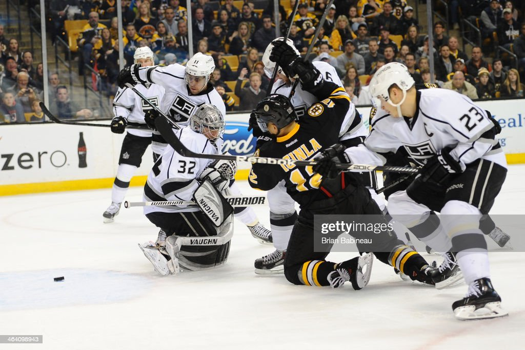 <a gi-track='captionPersonalityLinkClicked' href=/galleries/search?phrase=Jarome+Iginla&family=editorial&specificpeople=201792 ng-click='$event.stopPropagation()'>Jarome Iginla</a> #12 of the Boston Bruins fights for the puck against <a gi-track='captionPersonalityLinkClicked' href=/galleries/search?phrase=Anze+Kopitar&family=editorial&specificpeople=634911 ng-click='$event.stopPropagation()'>Anze Kopitar</a> #11, <a gi-track='captionPersonalityLinkClicked' href=/galleries/search?phrase=Jonathan+Quick&family=editorial&specificpeople=2271852 ng-click='$event.stopPropagation()'>Jonathan Quick</a> #32 and Dustin Brown #23 of the Los Angeles Kings at the TD Garden on January 20, 2014 in Boston, Massachusetts.