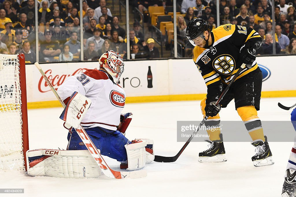 Jarome Iginla #12 of the Boston Bruins handles the puck against Carey Price #31 of the Montreal Canadiens in Game Seven of the Second Round of the 2014 Stanley Cup Playoffs at TD Garden on May 14, 2014 in Boston, Massachusetts.