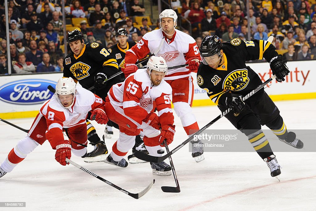 <a gi-track='captionPersonalityLinkClicked' href=/galleries/search?phrase=Jarome+Iginla&family=editorial&specificpeople=201792 ng-click='$event.stopPropagation()'>Jarome Iginla</a> #12 of the Boston Bruins handles the puck against <a gi-track='captionPersonalityLinkClicked' href=/galleries/search?phrase=Justin+Abdelkader&family=editorial&specificpeople=2271858 ng-click='$event.stopPropagation()'>Justin Abdelkader</a> #8 and <a gi-track='captionPersonalityLinkClicked' href=/galleries/search?phrase=Niklas+Kronwall&family=editorial&specificpeople=220826 ng-click='$event.stopPropagation()'>Niklas Kronwall</a> #55 of the Detroit Red Wings at the TD Garden on October 14, 2013 in Boston, Massachusetts.