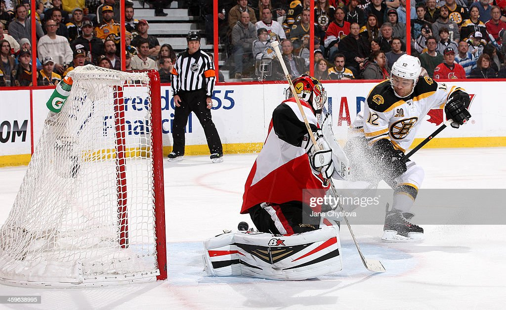 <a gi-track='captionPersonalityLinkClicked' href=/galleries/search?phrase=Jarome+Iginla&family=editorial&specificpeople=201792 ng-click='$event.stopPropagation()'>Jarome Iginla</a> #12 of the Boston Bruins tips the puck past <a gi-track='captionPersonalityLinkClicked' href=/galleries/search?phrase=Craig+Anderson&family=editorial&specificpeople=211238 ng-click='$event.stopPropagation()'>Craig Anderson</a> #41 of the Ottawa Senators for a goal during an NHL game at Canadian Tire Centre on December 28, 2013 in Ottawa, Ontario, Canada.
