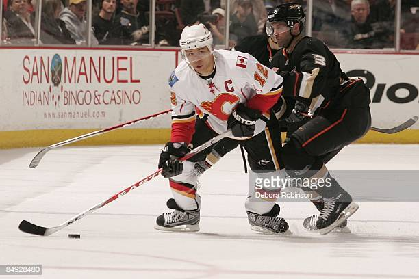 Jarome Iginla of the Calgary Flames drives the puck against Bret Hedican of the Anaheim Ducks during the game on February 11 2009 at Honda Center in...