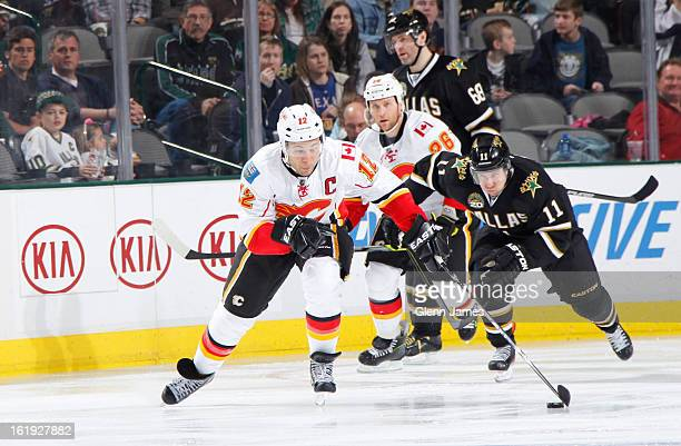 Jarome Iginla of the Calgary Flames handles the puck against Derek Roy of the Dallas Stars at the American Airlines Center on February 17 2013 in...