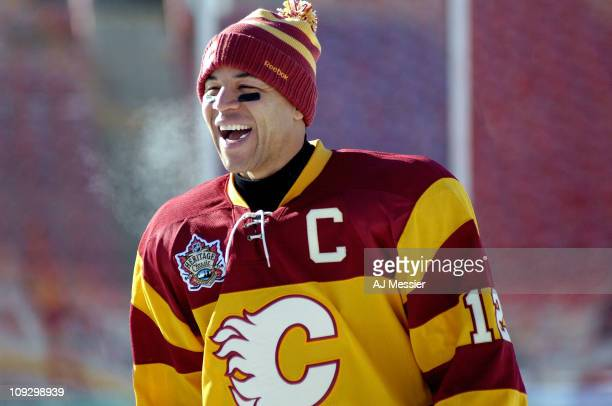 Jarome Iginla of the Calgary Flames laughs as he skates during practice for the 2011 Tim Hortons Heritage Classic at McMahon Stadium on February 19...