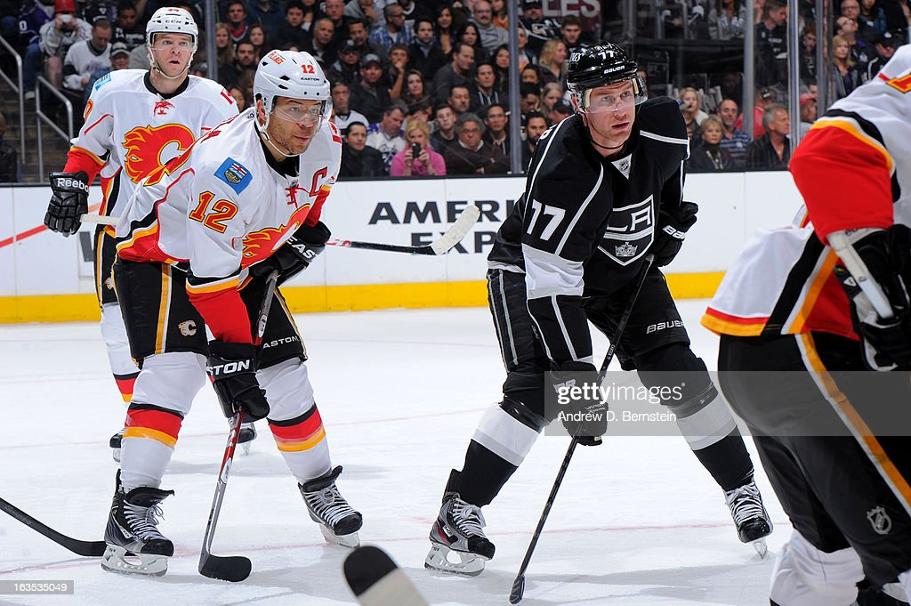 Jarome Iginla #12 of the Calgary Flames lines up for the faceoff against Jeff Carter #77 of the Los Angeles Kings at Staples Center on March 11, 2013 in Los Angeles, California.
