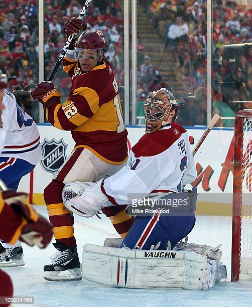 Jarome Iginla of the Calgary Flames moves through the crease in front of Carey Price of the Montreal Canadiens during the 2011 NHL Heritage Classic...