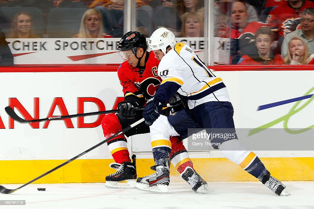 <a gi-track='captionPersonalityLinkClicked' href=/galleries/search?phrase=Jarome+Iginla&family=editorial&specificpeople=201792 ng-click='$event.stopPropagation()'>Jarome Iginla</a> #12 of the Calgary Flames skates against <a gi-track='captionPersonalityLinkClicked' href=/galleries/search?phrase=Brandon+Yip&family=editorial&specificpeople=817914 ng-click='$event.stopPropagation()'>Brandon Yip</a> #18 of the Nashville Predators on March 15, 2013 at the Scotiabank Saddledome in Calgary, Alberta, Canada.