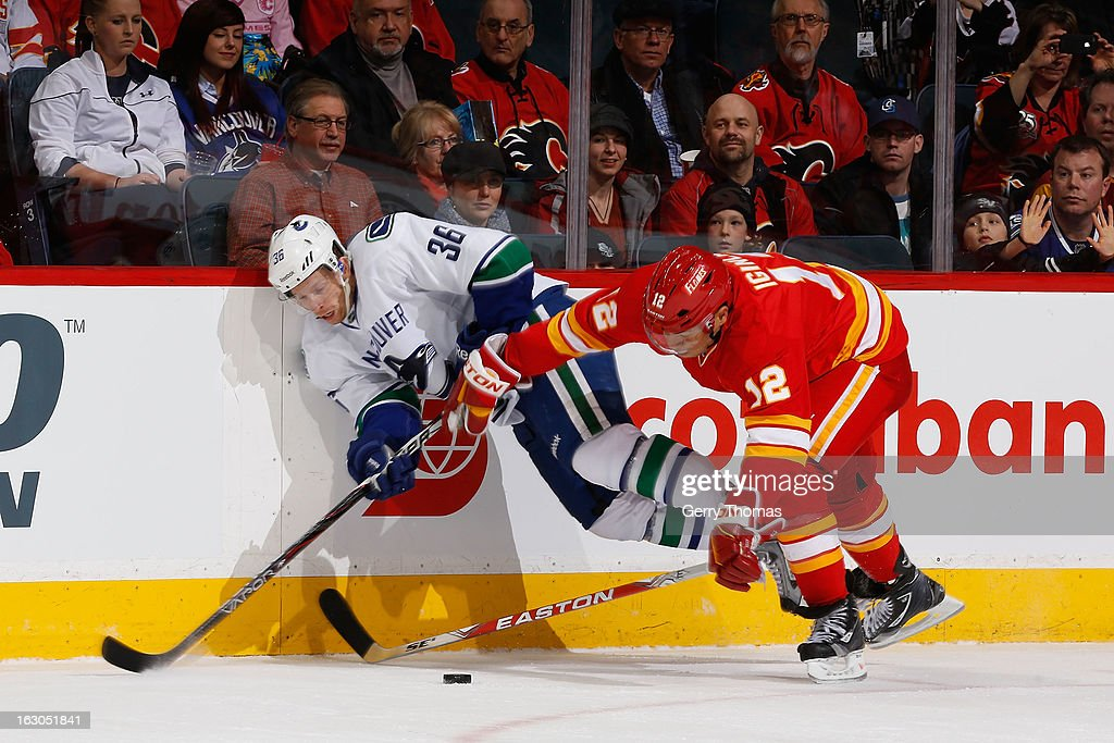 <a gi-track='captionPersonalityLinkClicked' href=/galleries/search?phrase=Jarome+Iginla&family=editorial&specificpeople=201792 ng-click='$event.stopPropagation()'>Jarome Iginla</a> #12 of the Calgary Flames skates against <a gi-track='captionPersonalityLinkClicked' href=/galleries/search?phrase=Jannik+Hansen&family=editorial&specificpeople=741716 ng-click='$event.stopPropagation()'>Jannik Hansen</a> #36 of the Vancouver Canucks on March 3, 2013 at the Scotiabank Saddledome in Calgary, Alberta, Canada.