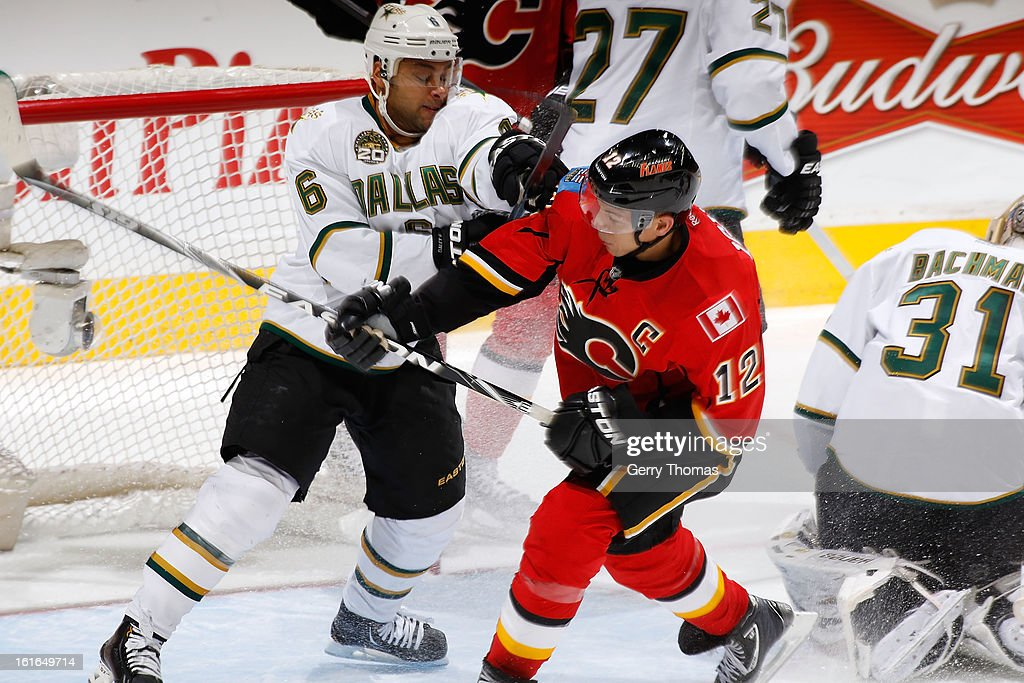 <a gi-track='captionPersonalityLinkClicked' href=/galleries/search?phrase=Jarome+Iginla&family=editorial&specificpeople=201792 ng-click='$event.stopPropagation()'>Jarome Iginla</a> #12 of the Calgary Flames skates against <a gi-track='captionPersonalityLinkClicked' href=/galleries/search?phrase=Trevor+Daley&family=editorial&specificpeople=213975 ng-click='$event.stopPropagation()'>Trevor Daley</a> #6 and Richard Bachman #31 of the Dallas Stars on February 13, 2013 at the Scotiabank Saddledome in Calgary, Alberta, Canada.