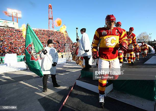 Jarome Iginla of the Calgary Flames walks out to the ice to play against the Montreal Canadiens during the 2011 NHL Tim Hortons Heritage Classic at...