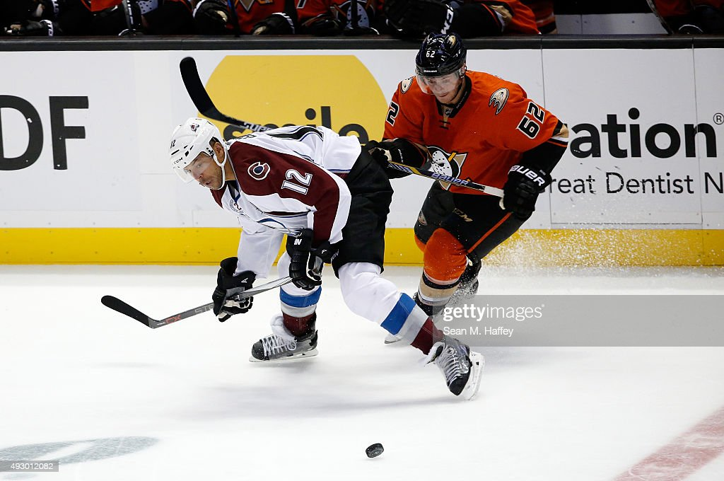 Jarome Iginla #12 of the Colorado Avalanche and Christopher Wagner #62 of the Anaheim Ducks battle for a loose puck during the third period of a game at Honda Center on October 16, 2015 in Anaheim, California.