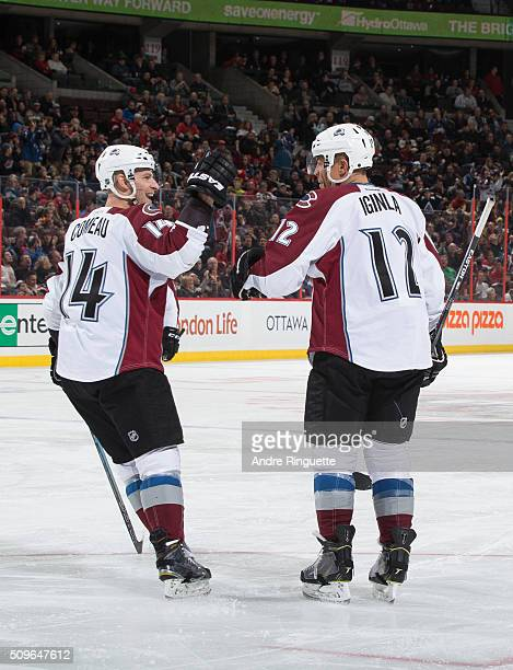 Jarome Iginla of the Colorado Avalanche celebrates his second period power play goal against the Ottawa Senators with teammate Blake Comeau at...