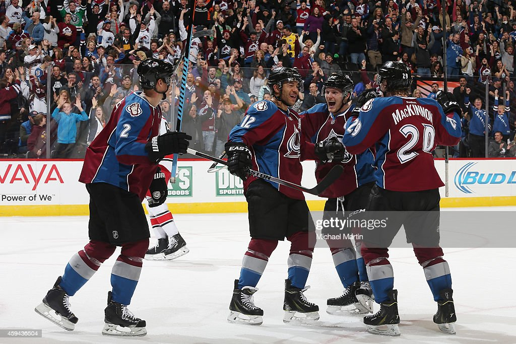 Jarome Iginla of the Colorado Avalanche celebrates with teammates Gabriel Landeskog Nathan MacKinnon and Nick Holden after scoring the gametying goal...
