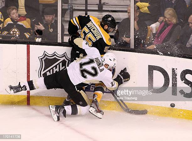 Jarome Iginla of the Pittsburgh Penguins and Johnny Boychuk of the Boston Bruins collide along the boards in the second period in Game Four of the...