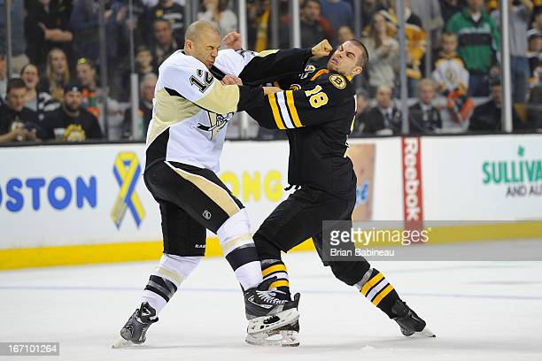 Jarome Iginla of the Pittsburgh Penguins fights against Nathan Horton of the Boston Bruins at the TD Garden on April 20 2013 in Boston Massachusetts