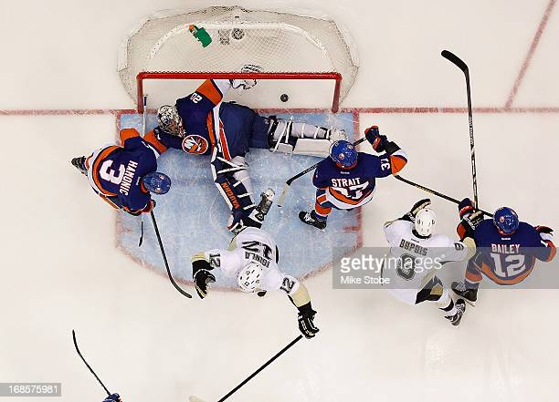 Jarome Iginla of the Pittsburgh Penguins scores a goal on Evgeni Nabokov of the New York Islanders in Game Six of the Eastern Conference...