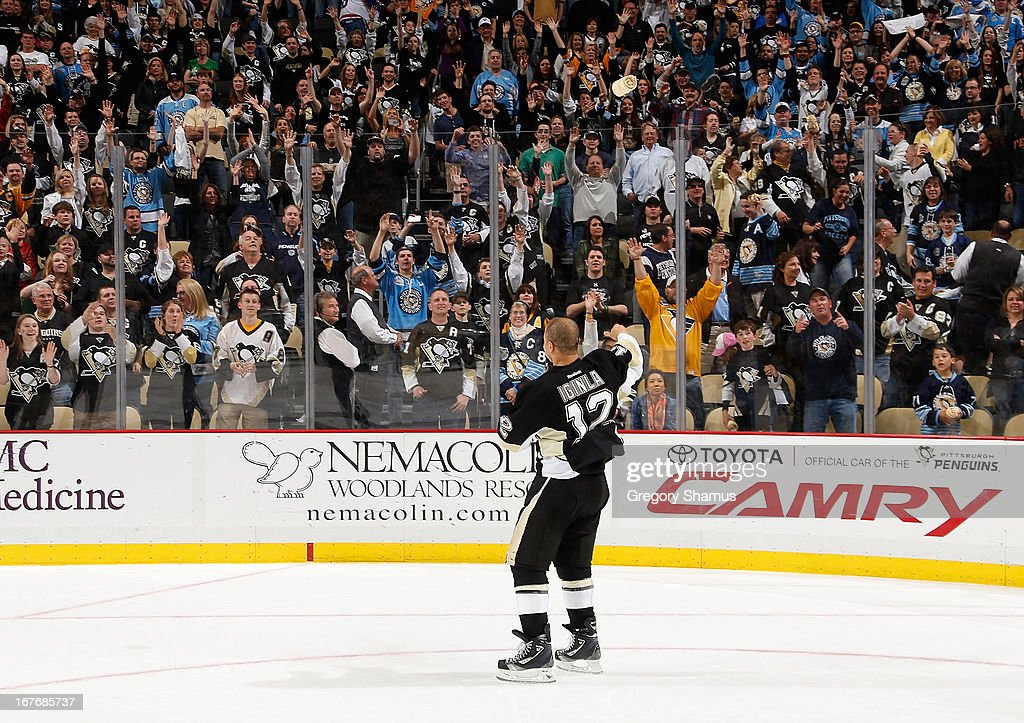 Jarome Iginla #12 of the Pittsburgh Penguins throws t-shirts into the stands as part of fan appreciation nigh after the game against the Carolina Hurricanes on April 27, 2013 at Consol Energy Center in Pittsburgh, Pennsylvania.