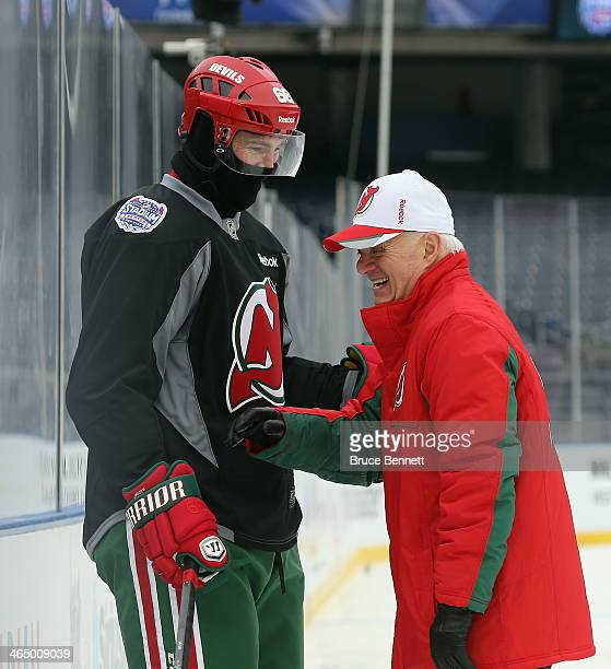 Jaromir Jagr and President and GM Lou Lamoriello of the New Jersey Devils chat on the ice the day before their outdoor game against the New York...