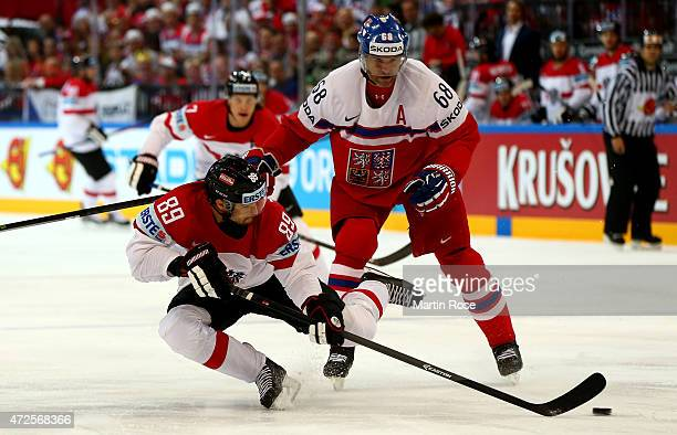 Jaromir Jagr of Czech Republic and Raphael Herburger of Austria battle for the puck during the IIHF World Championship group A match between Czech...