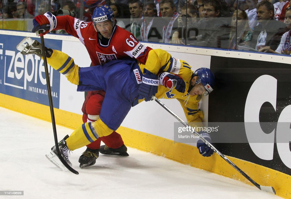 Jaromir Jagr (L) of Czech Republic smashes <a gi-track='captionPersonalityLinkClicked' href=/galleries/search?phrase=Carl+Gunnarsson&family=editorial&specificpeople=5557315 ng-click='$event.stopPropagation()'>Carl Gunnarsson</a> (R) of Sweden into the boards during the IIHF World Championship semi final match between Czech Republic and Sweden at Orange Arena on May 13, 2011 in Bratislava, Slovakia.