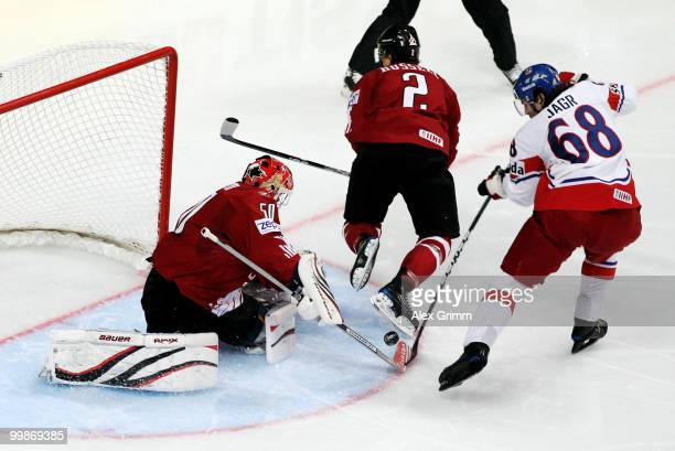 Jaromir Jagr of Czech Republic tries to score against Kris Russell and goalkeeper Chris Mason of Canada during the IIHF World Championship group F...