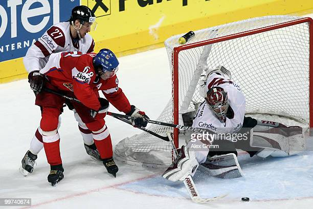 Jaromir Jagr of Czech Republic tries to score against Sergejs Pecura and goalkeeper Edgars Masalskis of Latvia during the IIHF World Championship...