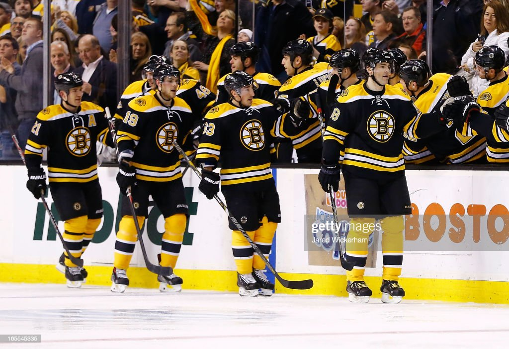 Jaromir Jagr #68 of the Boston Bruins is congratulated by teammates on the bench after scoring a goal in the second period during the game against the New Jersey Devils on April 2, 2013 at TD Garden in Boston, Massachusetts.