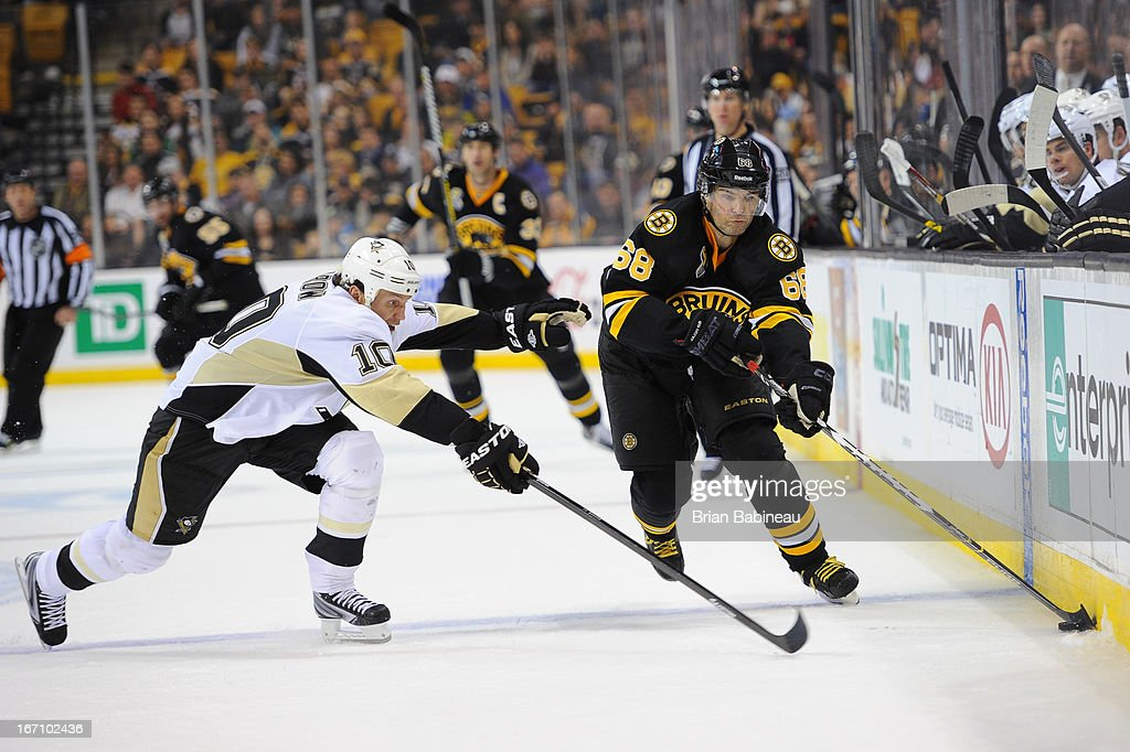 Jaromir Jagr #68 of the Boston Bruins skates with the puck against <a gi-track='captionPersonalityLinkClicked' href=/galleries/search?phrase=Brenden+Morrow&family=editorial&specificpeople=202256 ng-click='$event.stopPropagation()'>Brenden Morrow</a> #10 of the Pittsburgh Penguins at the TD Garden on April 20, 2013 in Boston, Massachusetts.