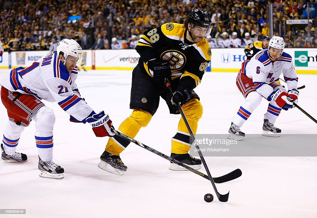 Jaromir Jagr #68 of the Boston Bruins skates with the puck past Derek Stepan #21 of the New York Rangers in Game Two of the Eastern Conference Semifinals during the 2013 NHL Stanley Cup Playoffs on May 19, 2013 at TD Garden in Boston, Massachusetts.