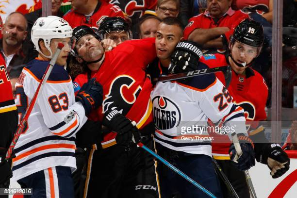Jaromir Jagr of the Calgary Flames gets involved with Darnell Nurse of the Edmonton Oilers after the whistle at Scotiabank Saddledome on December 2...