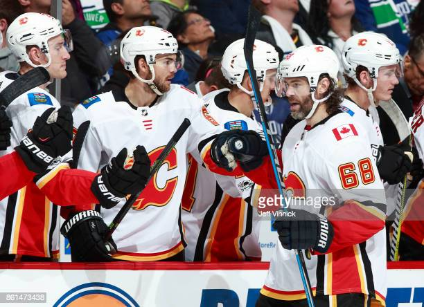 Jaromir Jagr of the Calgary Flames is congratulated by teammates after a Calgary goal during their NHL game against the Vancouver Canucks at Rogers...