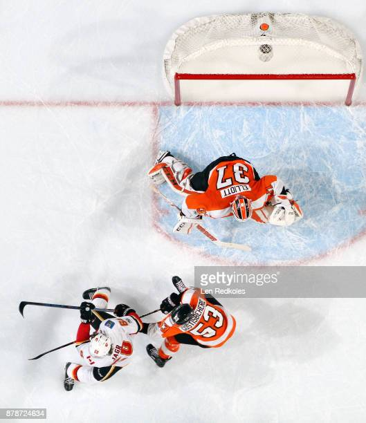 Jaromir Jagr of the Calgary Flames positions himself for a shot on goal against Shayne Gostisbehere and Brian Elliott of the Philadelphia Flyers on...