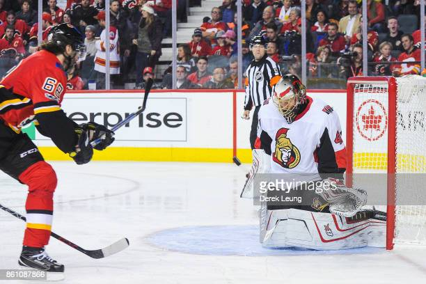 Jaromir Jagr of the Calgary Flames shoots the puck on Craig Anderson of the Ottawa Senators during an NHL game at Scotiabank Saddledome on October 13...