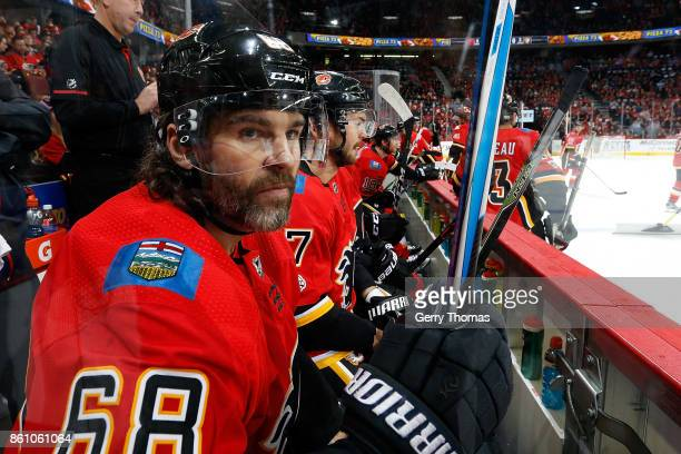 Jaromir Jagr of the Calgary Flames sits on the bench against the Ottawa Senators during an NHL game on October 13 2017 at the Scotiabank Saddledome...