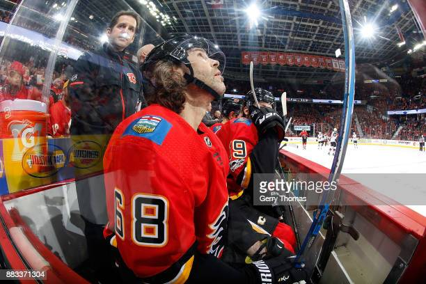 Jaromir Jagr of the Calgary Flames sits on the bench against the Arizona Coyotes during an NHL game on November 30 2017 at the Scotiabank Saddledome...