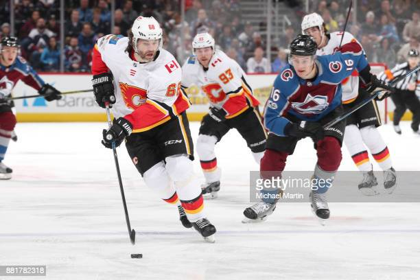 Jaromir Jagr of the Calgary Flames skates against Nikita Zadorov of the Colorado Avalanche at the Pepsi Center on November 25 2017 in Denver Colorado...