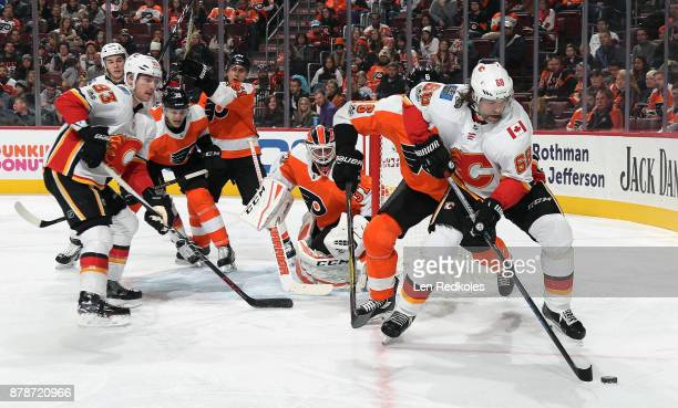 Jaromir Jagr of the Calgary Flames skates the puck on a scoring opportunity with teammate Sam Bennett against Travis Sanheim Mark Alt Valtteri...