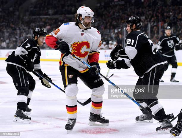 Jaromir Jagr of the Calgary Flames watches play between Oscar Fantenberg and Nick Shore of the Los Angeles Kings during the game against the Los...