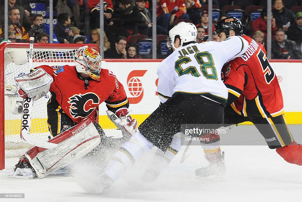 Jaromir Jagr #68 of the Dallas Stars battles for position with Mark Giordano #5 as Leland Irving #37 of the Calgary Flames guards the net during an NHL game at Scotiabank Saddledome on February 13, 2013 in Calgary, Canada. Flames won 7-4.