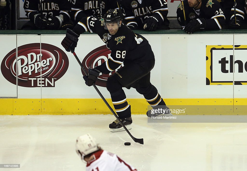 <a gi-track='captionPersonalityLinkClicked' href=/galleries/search?phrase=Jaromir+Jagr&family=editorial&specificpeople=201633 ng-click='$event.stopPropagation()'>Jaromir Jagr</a> #68 of the Dallas Stars skates the puck against the Phoenix Coyotes on opening night at American Airlines Center on January 19, 2013 in Dallas, Texas.
