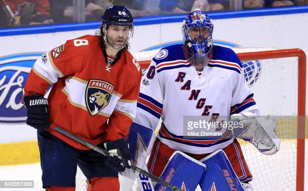 Jaromir Jagr of the Florida Panthers and Henrik Lundqvist of the New York Rangers look on during a game at BBT Center on March 7 2017 in Sunrise...