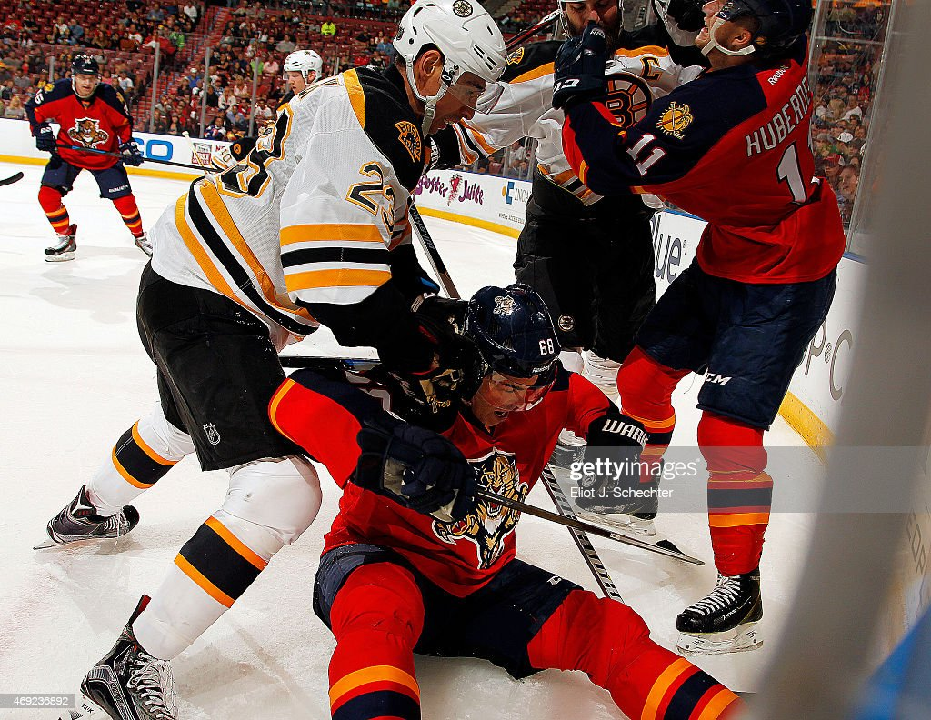 Jaromir Jagr of the Florida Panthers and teammate Jonathan Huberdeau tangle with Chris Kelly of the Boston Bruins and teammate Zdeno Chara during the...