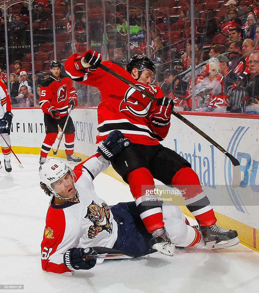 Jaromir Jagr #68 of the Florida Panthers hits the ice and trips up <a gi-track='captionPersonalityLinkClicked' href=/galleries/search?phrase=Andy+Greene&family=editorial&specificpeople=3568726 ng-click='$event.stopPropagation()'>Andy Greene</a> #6 of the New Jersey Devils during the first period at the Prudential Center on December 17, 2015 in Newark, New Jersey.