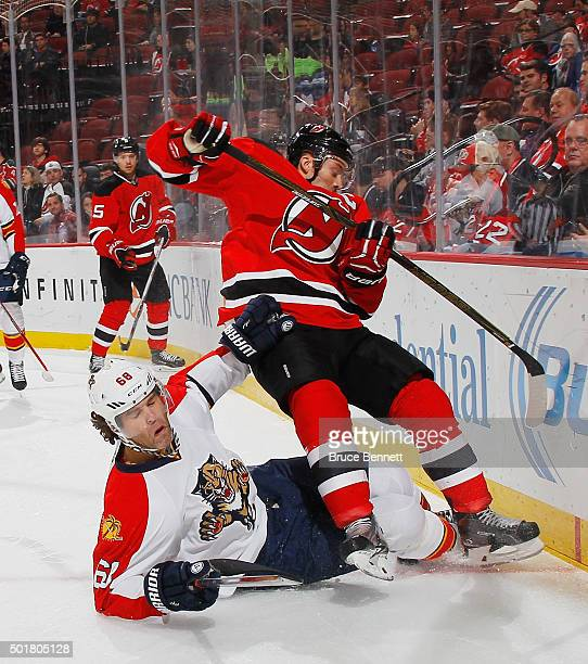 Jaromir Jagr of the Florida Panthers hits the ice and trips up Andy Greene of the New Jersey Devils during the first period at the Prudential Center...