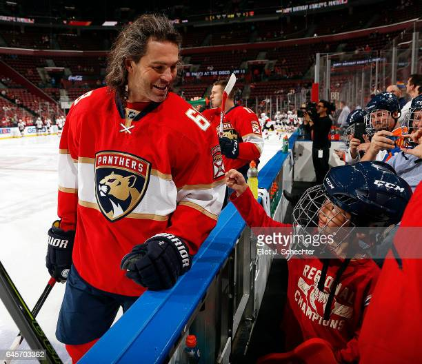 Jaromir Jagr of the Florida Panthers shares a smile with a young fan on the bench during warm ups prior to the start of the game against the Ottawa...