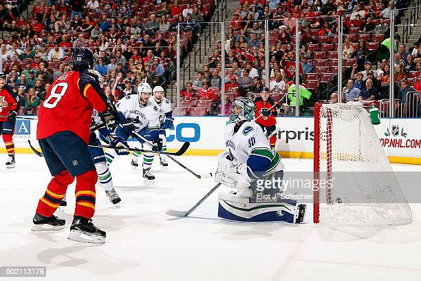 Jaromir Jagr of the Florida Panthers shoots and scores his 10th goal of the season against Goaltender Ryan Miller of the Vancouver Canucks at the BBT...
