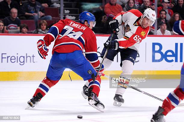 Jaromir Jagr of the Florida Panthers shoots the puck in front of Alexei Emelin of the Montreal Canadiens during the NHL game at the Bell Centre on...