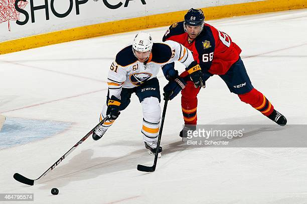 Jaromir Jagr of the Florida Panthers tangles with Andre Benoit of the Buffalo Sabres at the BBT Center on February 28 2015 in Sunrise Florida