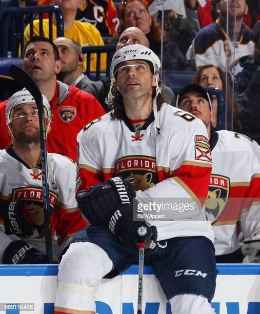 Jaromir Jagr of the Florida Panthers watches a presentation honoring Brian Gionta of the Buffalo Sabres prior to his 1000th career NHL game against...