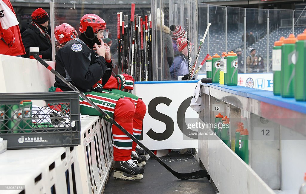 Jaromir Jagr #68 of the New Jersey Devils adjusts his equipment at the bench during the 2014 NHL Stadium Series practice session at Yankee Stadium on January 25, 2014 in New York City.